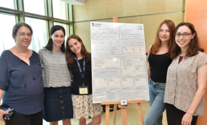 Leila Freedman and team with project poster