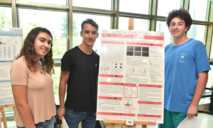 matthew blau and team with project poster